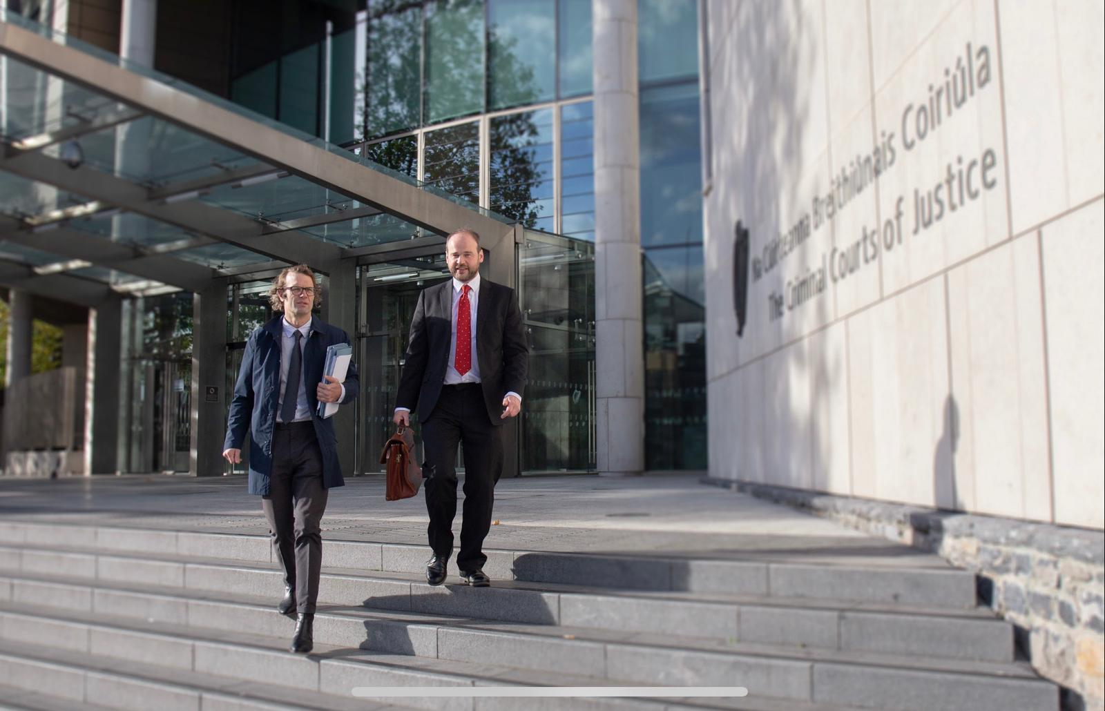 Solicitors on steps of the Criminal Courts of Justice